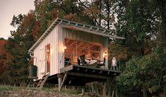 Off Grid Tiny House ❤ Tiny House WebsitesIn true self-reliant style, this off grid tiny house relies on its own water and heat sources, including rainwater collection for showers and oil lamps for light.  The cabin is constructed mainly from local wood.  They utilized a cantilevered deck and a garage door that opens to capture the view of the valley below.