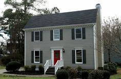 siding is Benjamin Moore Sandy Hook Gray, the shutters are Benjamin Moore Kendall Charcoal, and the front door is Sherwin Williams Real Red....