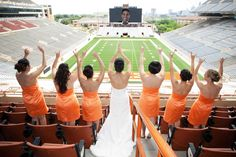 At the stadium of the University of Texas Longhorns--- don't love the orange dresses but the picture is an adorable idea