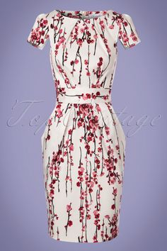 Blossom up your wardrobe with this romantic 60s Cherry Blossom Tulip Dress in Ivory!  Of course the bold print is amazing but if you take a closer look you'll see this dress is packed with surprising details such as the special cap sleeves and the stunning pleated pockets, wow! Made from an ivory white cotton blend with a light stretch and a romantic print of pink blossom. The waist belt ties at the back, cinching in the waist for a super feminine silhouette, simply adorable! &am...