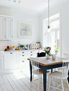 Perfect mix of clean bright white and rustic look...my idea of an awesome kitchen  white = bright during the long winter months