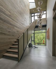 From rustic wood to modern metal, discover the top 70 best stair railing ideas. Explore stunning indoor staircase design inspiration and styles. House Design, Timber Walls, Feature Wall Design, Bubble Chandelier, Timber Feature Wall, Stair Railing, Stairs Design, Stairs, Luxury Lighting