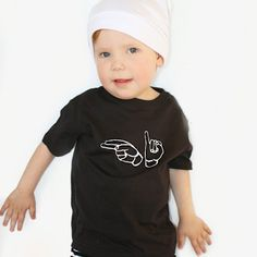 This shirt says Hi in American Sign Language - teach your child about sign language or just say hello to anyone! All items purchased are made to order. All of our black and white t-shirts and baby bodysuits are 100% cotton. Vinyl heat transfer material is used for the design. Whether from here or there, let your familys culture, history, and heritage shine through your little ones favorite piece of clothing. The International Hello collection is inspired our inter-racial family. We want to…