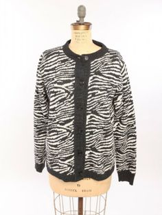 Zebra Cardigan: Made from 75% pre-consumer recycled cotton and 25% acrylic. This recycled fiber comes from waste product from apparel and furniture factories that would have otherwise been discarded. The feel is soft and the mid weight fabric matches perfectly with the relaxed fit. Manufactured in Upstate New York. $90