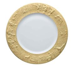 "Rosenthal's Magic Flute Sarastro dinnerware, inspired by Mozart's opera ""The Magic Flute"". White glazed porcelain with gold leaf detailing."