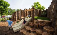 Natural playground hill slide. Earthscape Play