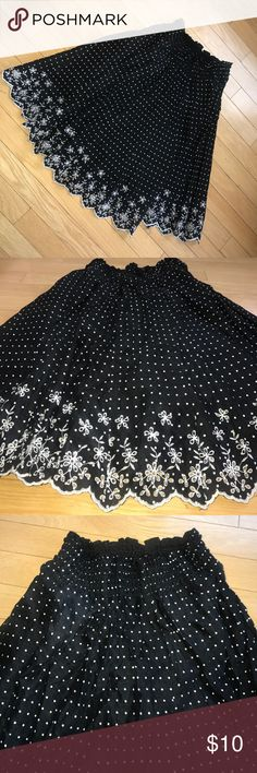 ⚫️WOMANS SMALL 100% COTTON MAMBA SKIRT ⚫️ ⚫️WOMANS SMALL 100% COTTON MAMBA SKIRT ⚫️ $10 black dot sale item . Price firm unless bundled. Pre- loved , good condition . Black and white polka dot, cinch waist ( can stretch ) flower detail bottom. Any questions just ask ! 🔴BUNDLE AND SAVE🔴 joe benbasset Skirts Circle & Skater