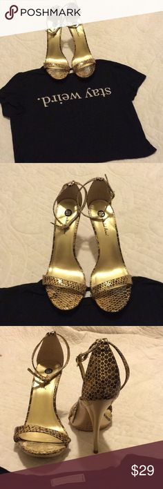 "🐍""Golden Snake"" 🐍 Michael Antonio HEELS Super sexy gold heels win snake print design. NWT. These are perfect for a night out when you want to standout!   HEEL HEIGHT Approx 5in   💁🏽REASONABLE OFFERS CONSIDERED.  💁🏽BUNDLE TO SAVE. OR FOR PERSONAL OFFER 💁🏽POSITIVE POSH VIBES Michael Antonio Shoes Heels"