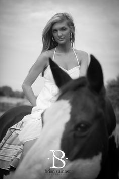 black and white lifestyle portrait with a sexy model and her horse