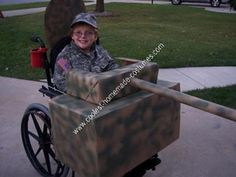 Homemade Army Tank Wheelchair Halloween Costume Idea: My son has Perthes and has been in a wheelchair off and on for five years.  It is hard to come up with ideas when in a chair, but this homemade army tank