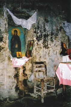 """Detail of shrine, """"Catacombs of Ayía Solomóni"""", Paphos, Cyprus. Note how the chair is as rotten as the walls. May 2003. Film scanned."""