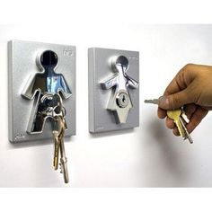 This works too so he (or you) won't lose the keys.  Amazon.com: Couple Human Key Holders (set of 2): Home & Kitchen  $31.90