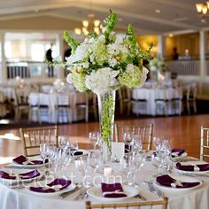 Hydrangea, cymbidium orchid and bells of ireland Centerpieces with a piece of jade green dendrobium orchid in the vase.