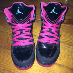 Jordan's Black, pink and blue women's/girls Jordans. Youth size 6 but they fit a woman's size 7. High top. Gum sole is splatter with the blue and pink colors and the tongue of the show is slight glitter pink. Jordan Shoes Sneakers