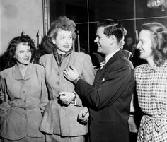 Lucille Ball appearing in Seattle in the stage play, Dream Girl, was made Honorary Dream Girl of Pi Kappa Alpha Fraternity in a ceremony yesterday in the Sigma Kappa Sorority house. Don Ireland, Pi K.A. president fastened the Dream Girl pin on Lucy. Margy McCurdy, 1947 Dream Girl of the Washington Chapter of pi K.A., and Nayna Frederick, president of Sigma Kappa participated in the festivities. (December 12, 1947)