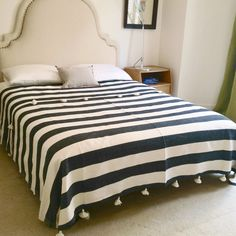 This striped bed cover would be the easiest DIY ever! A wide/home decor striped fabric, hem the edges, add a few handmade yarn tassels. Voila!