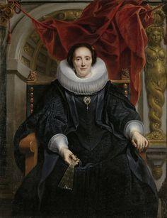 Jacob Jordaens (I) | Portrait of Catharina Behaghel, Jacob Jordaens (I), 1635 | De 38-jarige Catharina Behaghel is frontaal afgebeeld, gezeten in een brede leunstoel en met een gesloten waaier in de rechterhand. Zij draagt een zwart zijden kleed met een witte molenkraag en een vlieger, een manteltje met loshangende mouwen. Zij draagt parelsnoeren om de hals en de polsen en een bergkristallen medaillon op de borst. De achtergrond wordt afgesloten door een halfronde nis, waarvoor een rood…