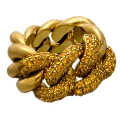 """POMELATTO """"GOURMETTE"""" YELLOW SAPPHIRE FELXIBLE GOLD LINK RING -  This Pomellato ring is composed of beautifully crafted flexible chain links of 18k yellow gold. Some are unadorned while those on top are covered in a pave of yellow sapphires that reflect light for a special shine."""