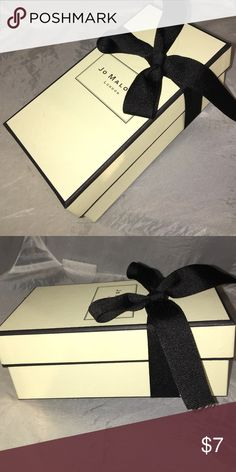 """Jo Malone creamy ivory gift box black bow Jo Malone gorgeous classic gift box - sturdy board - creamy ivory with black trim and a matching black satin bow.  No inserts inside - just a piece of folded black tissue that held my candle.  Only used to bring my candle home!  Measures approx 7"""" X 3 1/2"""" X 2 1/2"""".  From a smoke free home! Jo malone Accessories"""