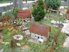 Had to share....one of the best EVER miniature gardens I've seen! ~~ Sue Diana used rusted metal for roofing