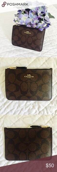 Coach Coin/ID Card Case with Keychain Classic monogram print with keychain to attach to your keys so you never forget your ID, credit card or coins at home!  Roughly 3.5 inches by 5 inches.  Brand new with tags; never used!  All offers considered! Coach Bags Wallets