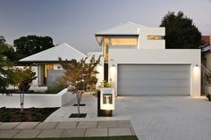 Luxury Home Builder Perth - Exclusive Homes by Cambuild Modern Exterior, Exterior Design, Modern Garage, Exterior Paint, Illuminated House Numbers, House Color Schemes, Colour Schemes, Paint Your House, Exclusive Homes