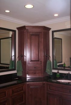 Corner bathroom sink vanity with some light and also double mirror ...