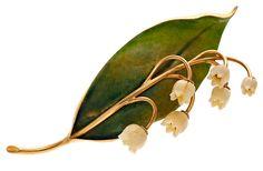Broche floral en oro, esmalte y marfil