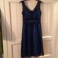 "Beautiful Lacey dress! EUC! Nanette Lepore sleeveless dress, light blue slip lining w/black lace dress on top, no stains or tears, hem hits just below knee, 32"" from v-neck to hem, size 4, hardly worn, like brand new! Nanette Lepore Dresses Midi"