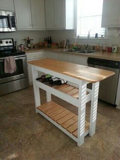 I LOVE this clever small kitchen island. It's fairly easy to DIY and it can store up to 18 bottles of wine! 9 Ingenious Small Kitchen Storage Ideas: A Kitchen Island That Stores Wine Kitchen Island On Wheels, Kitchen Island Cart, Kitchen Islands, Island Table, Island Bar, Islands For Small Kitchens, Wood Islands, Narrow Kitchen Island, Kitchen Carts
