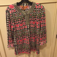 Tory Burch silk tunic size large Great condition. No stains or damage. All collar beads are intact. Colors are: pink, green, white, and very dark navy/black. Tory Burch Tops Tunics