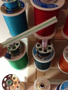 Tip for keeping bobbins with spools of thread - a plastic drinking straw: