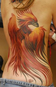 tat by ryan hadley, bird, back tattoo