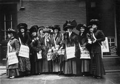 A band of 'news girls' of the Women's Suffrage Movement prepare to invade New York's Wall Street, armed with leaflets and slogans demanding votes for women.