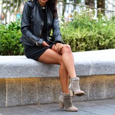 Ashley Torres is wearing a dress from Naven, leather jacket from Zara, and the boots are from Sole Society