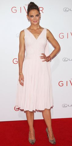 Katie Holmes revealed her softer side in a pretty pearl plisse chiffon Zac Posen dress, styling her look with Lorraine Schwartz jewelry and neutral pumps.