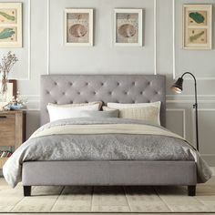 Beautify the bedroom with this stylish tufted platform bed. Featuring a gorgeous linen headboard, a sturdy wood frame and a shiny black finish, this bed includes a set of rails and 26 Euro system slats to support the mattress.