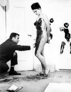 Yves Klein directs paint-smeared women in Anthropometries of the Blue Epoch at the Galerie internationale d'art contemporain, Paris, March 9, 1960. Photo by Charles Wilp.