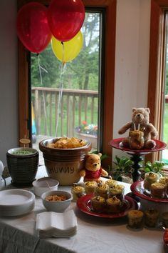 Another shot of the table decorations for the winnie the pooh bear picnic birthday party