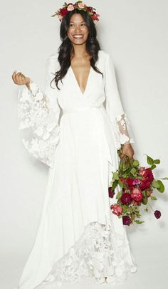 plus size bride wearing a romantic lace wedding dress by Claire Pettibone. I love the
