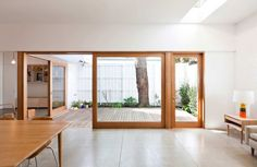 Back doors opening out onto a deck House Eadie by Tribe Studio - wood frame windows and doors warm up the beautiful Fibro cement floors! Patio Interior, Interior And Exterior, Interior Design, Bathroom Interior, Big Doors, Windows And Doors, Sliding Doors, Timber Windows, Casa Patio