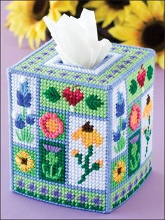 Plastic Canvas - Tissue Topper Patterns - Boutique-Style Patterns This tissue cover displays a beautiful collection of florals. Made with medium (worsted) weight yarn and plastic canvas. Plastic Canvas Ornaments, Plastic Canvas Tissue Boxes, Plastic Canvas Crafts, Plastic Canvas Patterns, Cross Stitch Embroidery, Cross Stitch Patterns, Yarn Crafts, Diy Crafts, Box Spring Cover