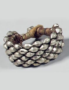 India | Bracelet; silver and cord. Ø 6,5 cm, 78 grs | Est. 400 - 450€ ~ (Dec '14)