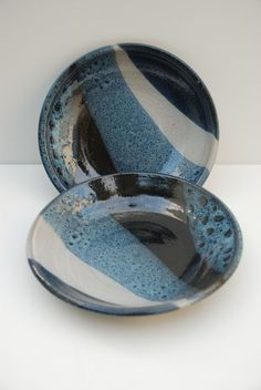 Liz Comay - Ceramic plates, layering black and white and blue: