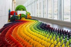 Li Hongbo Arranges Thousands Of Paper Objects Into a giant rainbow installation. #rainbow