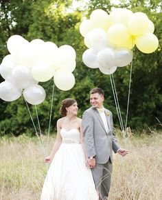 Photo: L Photographie  // Feature: The Knot  Love the grouped small balloons with I e bug string!