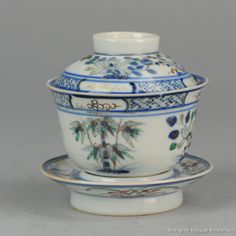 18/19C Chinese Porcelain Lidded Tea Bowl On Foot Qing Antique Rare Kangxi Mark A very nice example, great bowl with an unusual scene. Marked Kangxi for a similar example see https://www.aspireauctions.com/#!/catalog/308/1265/lot/43170 http://shangrila-antique.com/product/1819c-chinese-porcelain-lidded-tea-bowl-foot-qing-antique-rare-kangxi-mark/