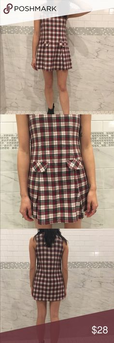 Vintage 90's Plaid Grunge Dress Bring back the grunge days in this amazing Plaid dress features fake pockets and the cutest pleating at the bottom Wear with fishnets and docs to make it even more grungy   * Brand Jealous by Kathy of California  * Size unknown best fit xs/a * Length 30 inches Bust 30 inches  * Model is 5'4 size xs/s 24/25  * Not UNIF UNIF Dresses Mini