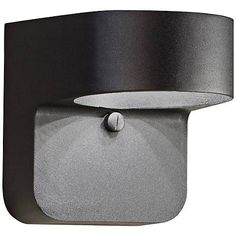 Textured black finish enhances the modern look of this Dark Sky compliant LED outdoor wall light.