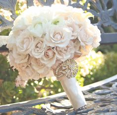 with soft purple roses surrounding the white roses?